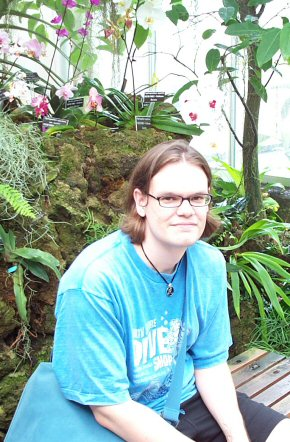 Andrew Posed With Orchids.jpg